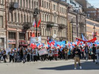 Россия. Санкт-Петербург. Демонстрация на Невском проспекте. Demonstration on the Nevsky Prospect in St. Petersburg, the first of May. Фото nikey-Depositphotos