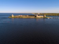 Крепость Орешек (Шлиссельбург). View of the Oreshek fortress on a May evening (aerial photography). Leningrad region, Russia. Фото sikaraha - Depositphotos