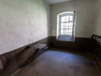 Крепость Орешек. Single cell in the Old prison at the ancient Oreshek fortress. Russian Medieval defensive fortress and political prison. Фото blinow61 - Depositphotos