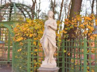 Statue of the goddess of Nemesis in Summer Garden at autumn evening, St.Petersburg, Russia. Ancient Greek mythology. Фото konstsem - Depositphotos