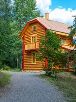 Mandrogi, Russia , Karelia Region, , a house in traditional style of the village on the Svir river bank. Фото giuseppemasci.me.com-Depositphotos