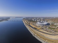 Россия. Волгоград. Volga river on the right hand - construction site of the football stadium Volgograd arena for the FIFA World Cup 2018. Фото d_oleg - Depositphotos