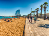 Испания. Каталония. Барселона. A sunny day on the Barceloneta beach, Barcelona, Catalonia, Spain. Фото marcorubino - Depositphotos